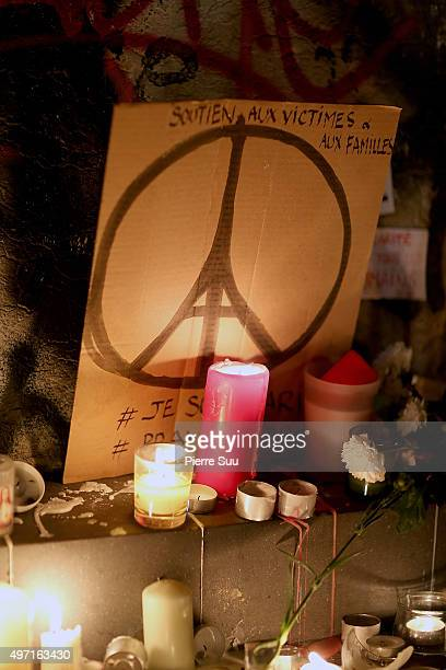 Candles and signs at a spontaneous gathering of Parisians are left at Place de la Republique on November 14 2015 in Paris France At least 120 people...