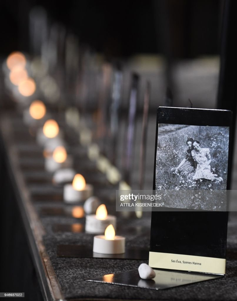 candles and stones are seen next to photos of jewish hungarian