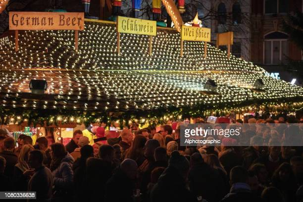 candles and toy soldiers  on an outdoor christmas market stall selling gluwein - birmingham england stock pictures, royalty-free photos & images