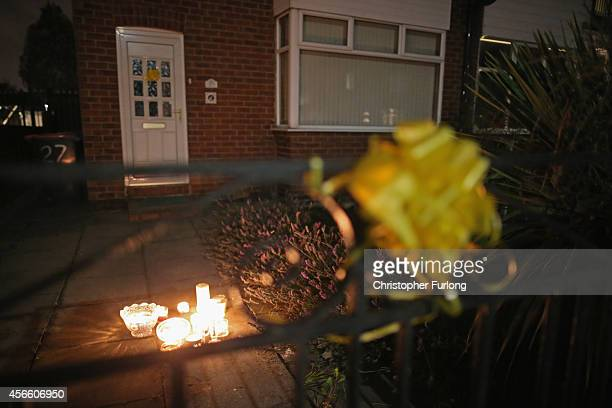 Candles and tributes lit by neighbours adorn the front of aid worker Alan Henning's home in Eccles who has been reportedly murdered by Islamic State...