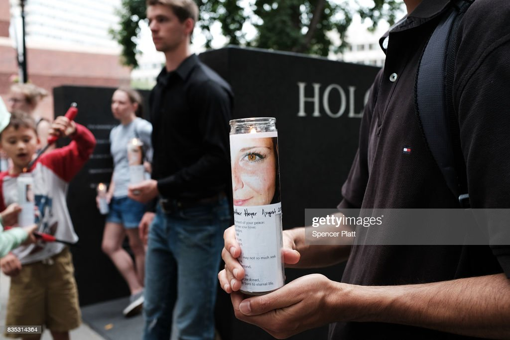 Candles are adroned with a picture of Heather Heyer at a vigil and march at the New England Holocaust Memorial to denounce hate groups before a controversial rally tomorrow on August 18, 2017 in Boston, Massachusetts. Heyer was killed last Saturday when a car rammed into a crowd of counterprotesters at a white nationalist rally in Charlottesville, Virginia. A free speech rally planned on Saturday on Boston Common has sparked fears of possible violence only a week after racially charged protests in Charlottesville, Virginia, turned deadly. Thousands of counter protesters are expected to attend the event which police vow to keep peaceful.