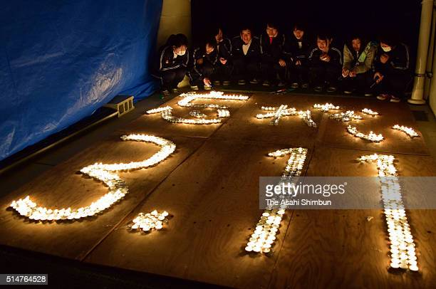 Candles are arranged to form '3.11' to commemorate the victims of the earthquake and tsunami on the fifth anniversary of the Great East Japan...