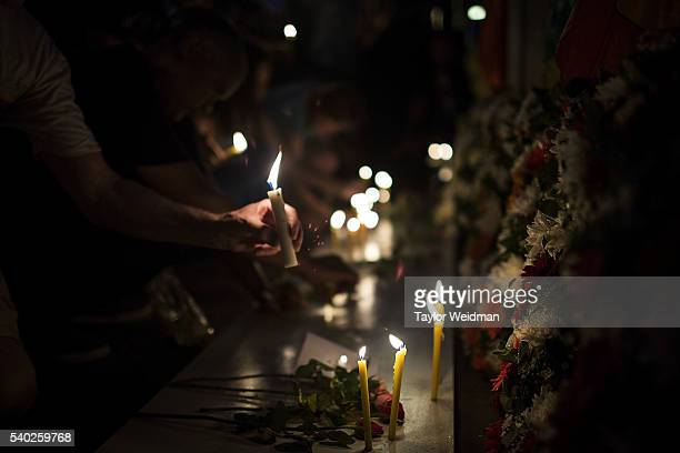 Candles are displayed in front of a gay pride flag during a candlelight vigil outside the United States Consulate on June 14 2016 in Chiang Mai...