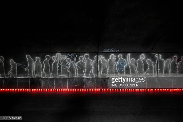 Candles are displayed in the tunnel near the Love Parade Memorial on July 23, 2020 in Duisburg, western Germany, on the eve of the day marking 10...