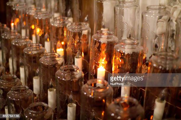 Candles are lit as a special mass for the people of Mexico and Puerto Rico is held at Saint Patrick Church in Norristown, PA, on September 21, 2017.