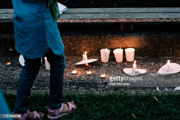 Candles are lit as people attend a vigil for the lives taken in the Christchurch terror attacks at the Auckland Domain on March 22 2019 in Auckland...