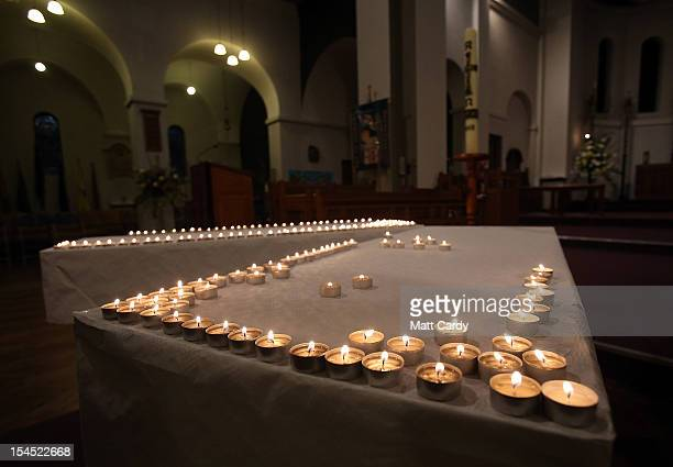 Candles are lit as people gather for a special service of prayer and reflection held for those affected by the hitandrun incidents in Cardiff at the...