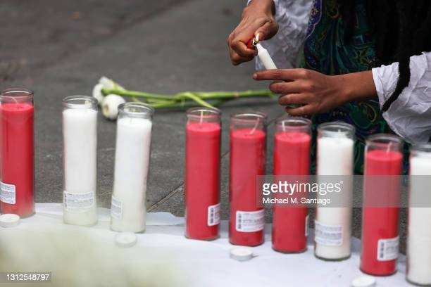 Candles are lit at a makeshift memorial during a vigil for Daunte Wright and Dominique Lucious at Washington Square Park in Manhattan on April 14,...