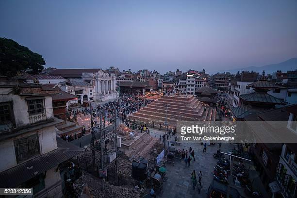 Candles are lit during a commemorative program held at Kathmandu Durbar square on April 24 2016 in Kathmandu Nepal A 78magnitude earthquake struck...