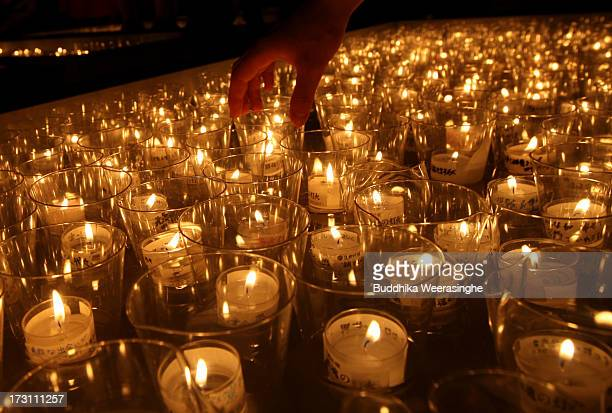 Candles are lit during the Tanabata festival at the Hatamono shrine on July 7, 2013 in Osaka, Japan. Tanabata is a Japanese star festival in which...