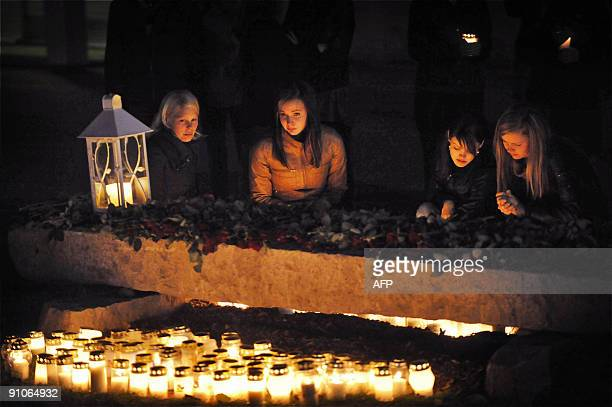 Candles are lit in the evening by the memorial next to the Kauhajoki vocational school in Kauhajoki on September 23 2009 for those killed in the...