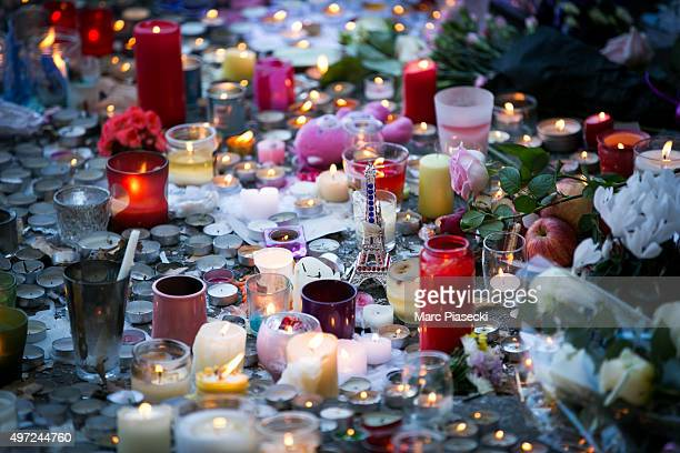 Candles are lit near the 'Bataclan' theatre as France observes three days of national mourning on November 15, 2015 in Paris, France. As France...