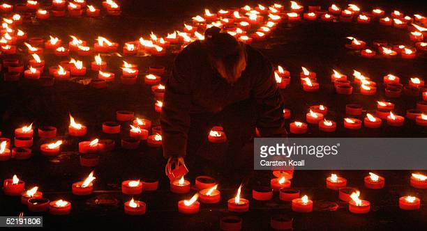 Candles are placed in the old marketplace to commemorate victims of WW II on February 13 2005 in Dresden eastern Germany 60 years ago on February...