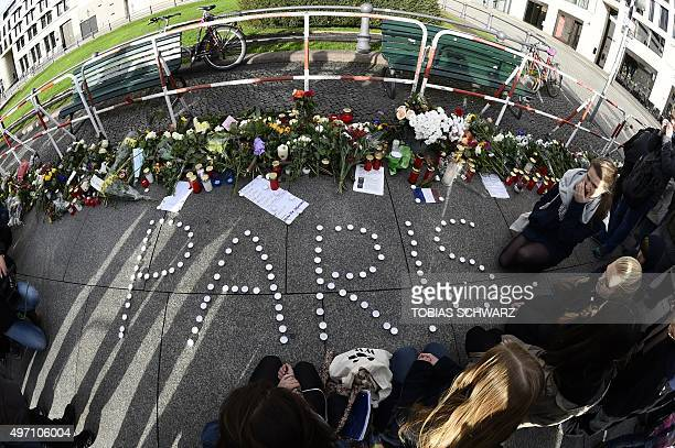 Candles are placed outside the French Embassy to form 'Paris' in Berlin on November 14 a day after deadly attacks in Paris The string of coordinated...