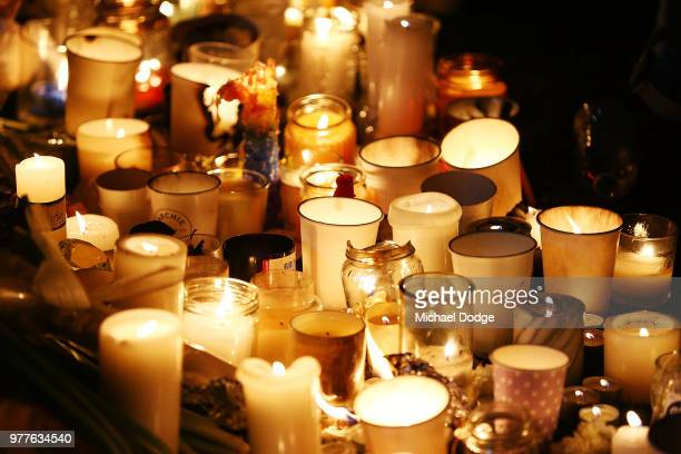 Candles are seen during a vigil held in memory of murdered Melbourne comedian 22yearold Eurydice Dixon at Princess Park on June 18 2018 in Melbourne...