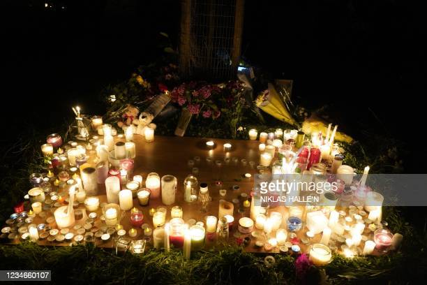Candles are seen during a vigil in North Down Crescent Park in the Keyham area of Plymouth, southwest England, on August 13, 2021 in memory of the...