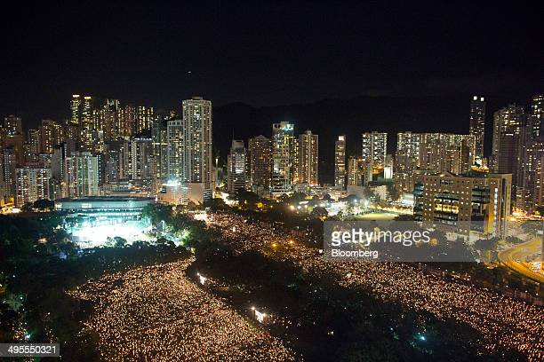 Candles are seen from above during a vigil at Victoria Park in Hong Kong, China, on Wednesday, June 4, 2014. Thousands of people attended a vigil in...