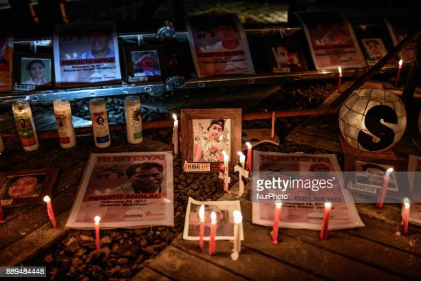 Candles are seen next to pictures of victims of extrajudicial killings during a vigil in Quezon city Metro Manila Philippines December 1 2017 On...