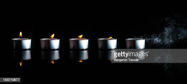 Candles being successively blown
