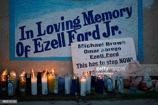 Candles burn at a memorial for Ezell Ford December 5 2014 in Los Angeles California 25yearold Ezell Ford who had been diagnosed with depression...
