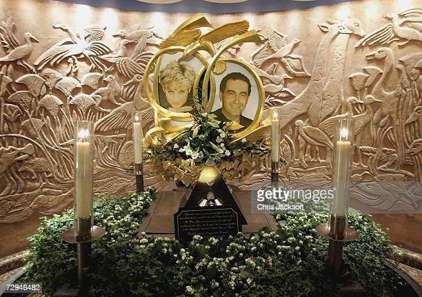 Candles burn beside The Diana Princess of Wales and Dodi Fayed memorial in Harrods on January 8 2006 in London England An inquest into the deaths of...