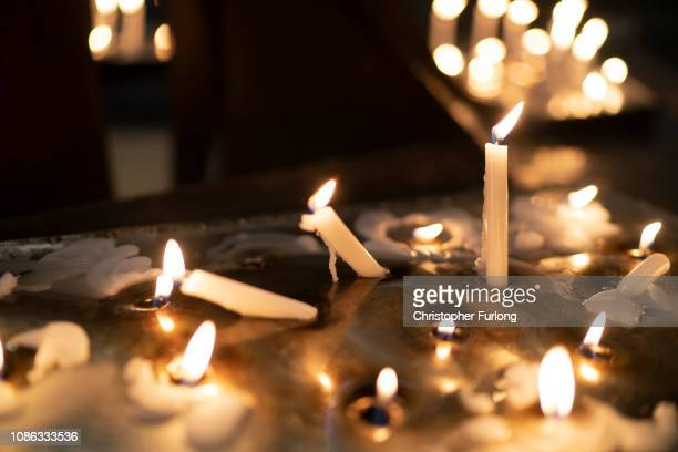 Candles burn inside a church as shoppers make their last minute purchases on Christmas Eve on December 24 2018 in Birmingham England Financial...