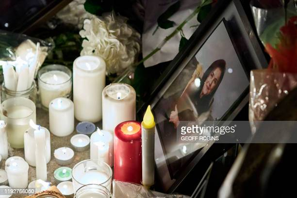 Candles burn near a portrait of one of the victims of Ukrainian Airlines flight 752 which crashed in Iran during a vigil at Mel Lastman Square in...