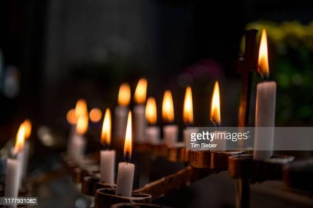 candles burning in a catholic church - 復活徹夜祭 ストックフォトと画像
