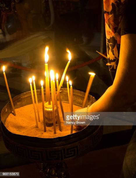 candles burning in church of the holy sepulchre. - stations of the cross stock pictures, royalty-free photos & images