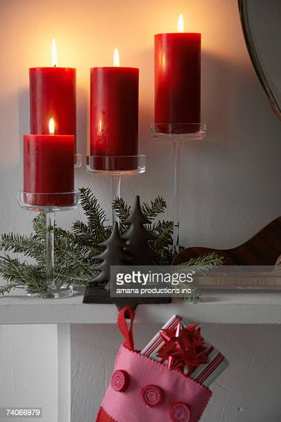 candles burning near christmas decorations - christmas decore candle stock pictures, royalty-free photos & images