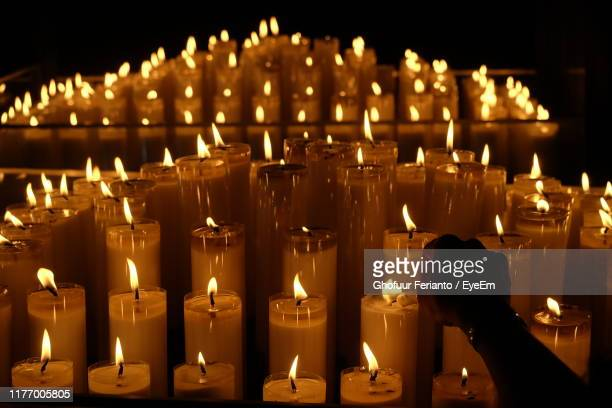 candles burning on table in church - large group of objects stock pictures, royalty-free photos & images