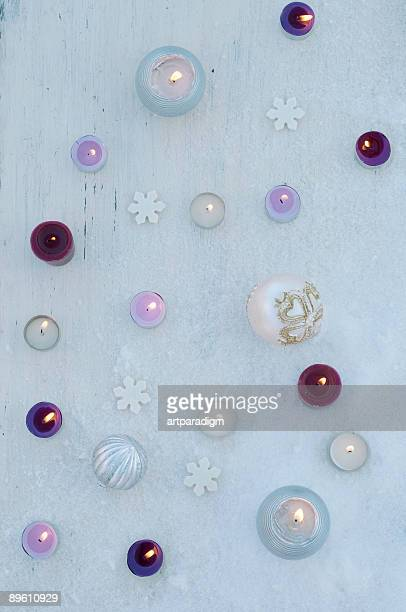Candles decoration on the white wooden board