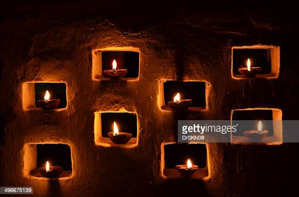 candles decoration on wall in diwali - diwali decoration stock pictures, royalty-free photos & images