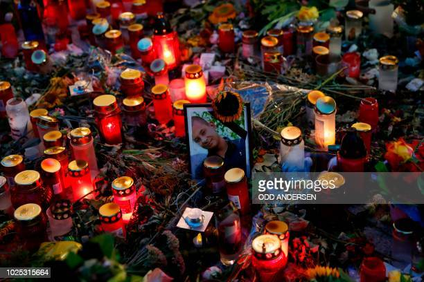 Candles, flowers and a picture of the victim of last weekend's fatal stabbing have been left at a makeshift memorial in Chemnitz, eastern Germany on...
