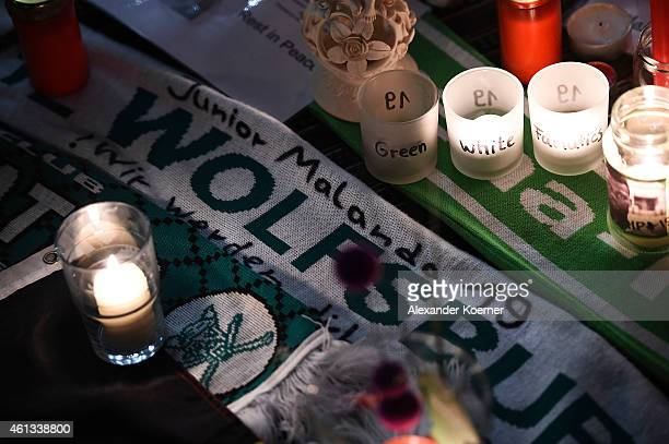 Candles flowers and pictures lie on the ground in the entrance hall of VFL Wolfsburg stadium in memory of midfielder Junior Malanda on January 11...