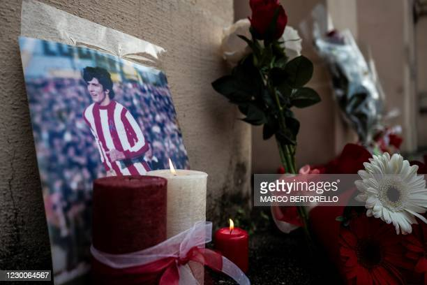 """Candles, flowers and the portrait of former Italan football player Paolo Rossi are pictured out of the Romeo Menti"""" stadium in Vicenza, northeastern..."""