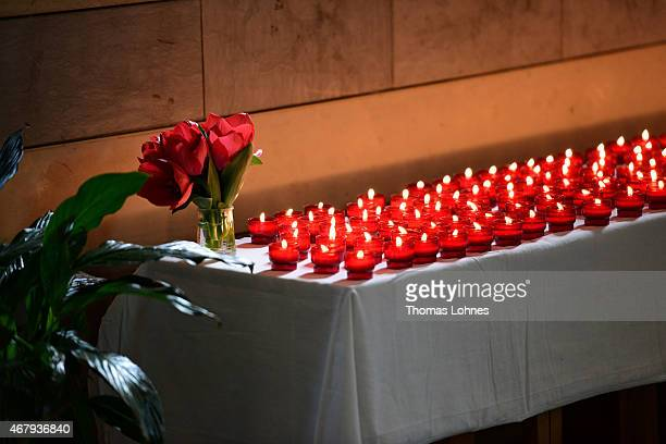 Candles for the victims of Germanwings Airbus fight sit on a table during a church service at the altar at the cathedral 'Notre Dame du Bourg' on...