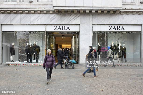 Candles for the victims of yesterday's attack on Berlin's Christmas market sit outside a Zara clothing fashion store operated by Inditex SA in Berlin...