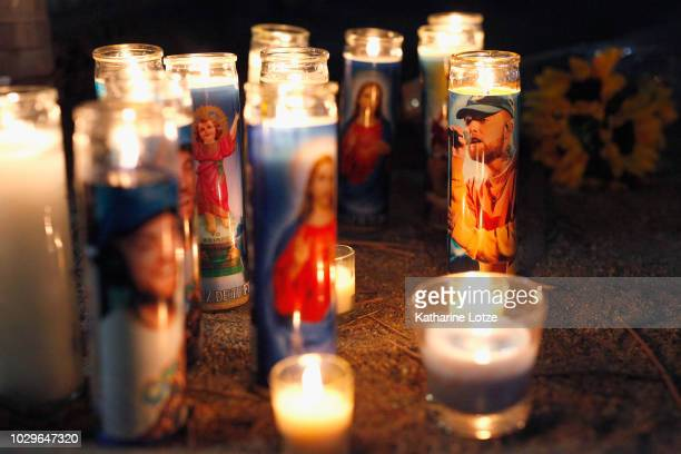 Candles form a memorial to late rapper Mac Miller at the corner of Fairfax and Melrose Avenues on September 8 2018 in Los Angeles California Miller...