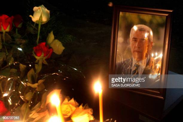 TOPSHOT Candles have been litten on the spot where leading Kosovo Serb politician Oliver Ivanovic was killed in a brazen driveby shooting in...