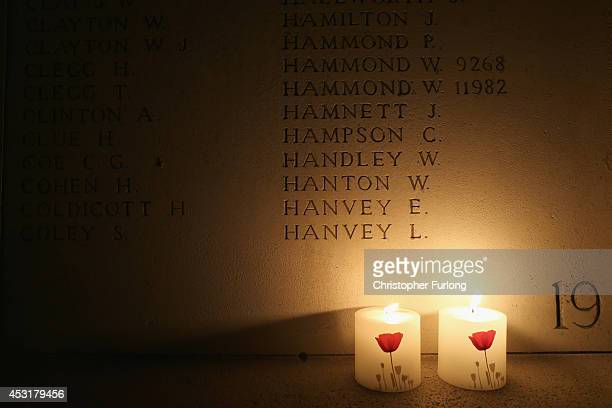 Candles illuminate the names of missing soldiers at the Menin Gate Memorial to the Missing as the lights are turned off on iconic buildings during a...