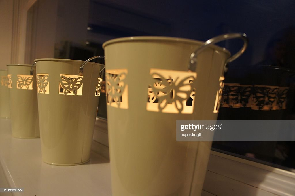 Candles in a bucket : Stock Photo