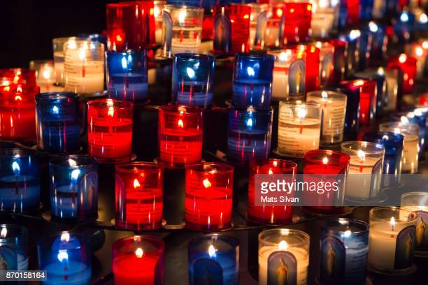 candles in cathedral - memorial event stock pictures, royalty-free photos & images