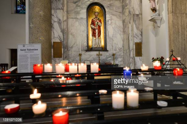Candles in the chapel with the statue and relics of patron saint of love, St. Valentine, inside Whitefriar Church in Dublin. On St. Valentine's Day,...