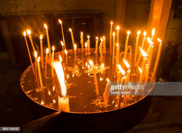 candles in the church of the holy sepulchre. - stations of the cross stock pictures, royalty-free photos & images