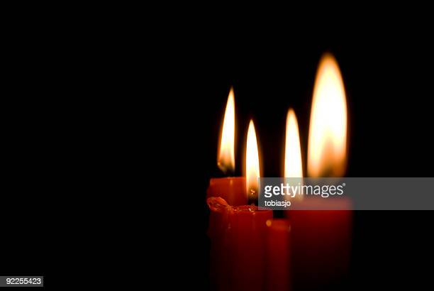 candles in the dark - candle in the dark stock pictures, royalty-free photos & images