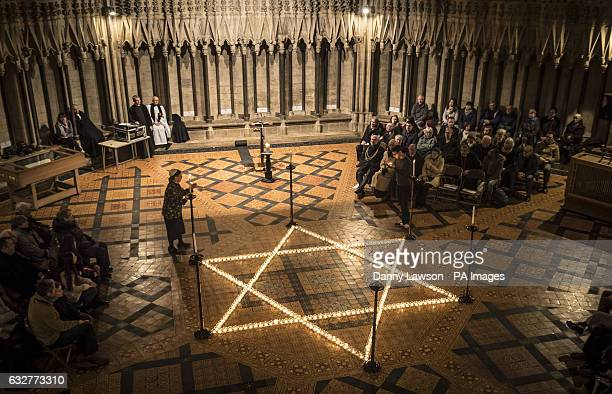 600 candles in the shape of the Star of David are seen during a commemoration for Holocaust Memorial Day at York Minster York