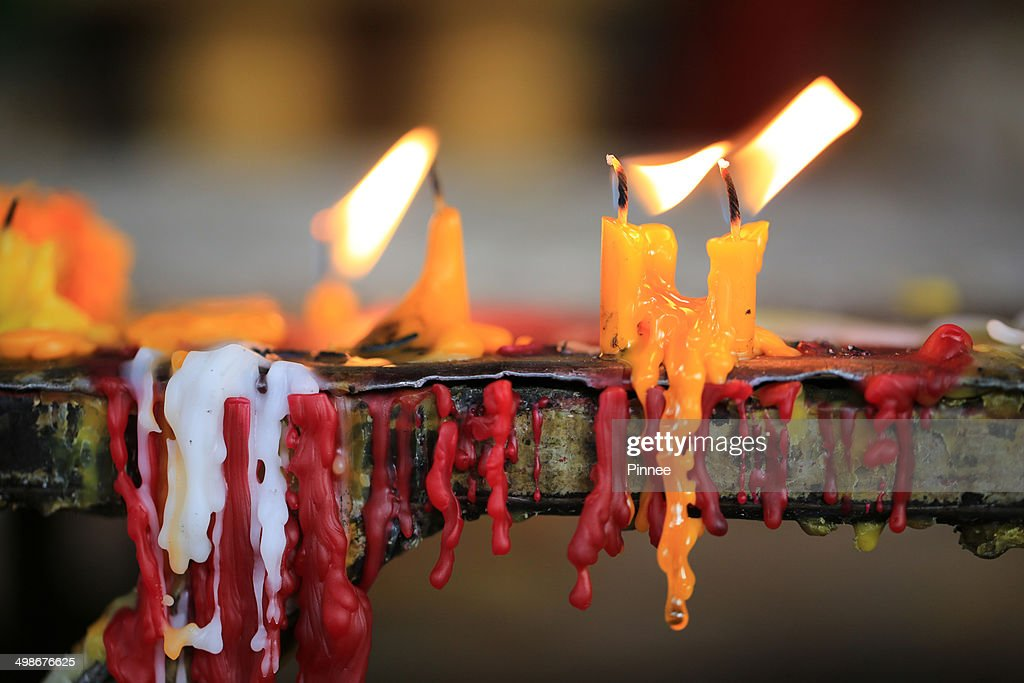Candles in Wat Si Muang in Vientiane Laos. : Stock Photo