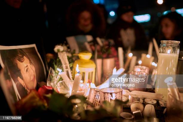 TOPSHOT Candles light a photo of one of the victims of Ukrainian Airlines flight 752 which crashed in Iran earlier during a vigil at Mel Lastman...