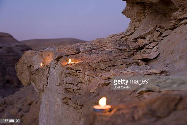 candles line a canyon wall outside mar saba monastery - historical palestine stock pictures, royalty-free photos & images